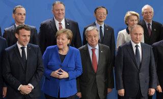 Участники саммита в Берлине договорились соблюдать запрет на поставки оружия в Ливию