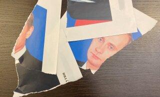 В Петербурге депутат порвал портрет Путина. Что ему за это будет?