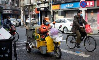 ФОТО | В Ухани сняли действовавший два месяца карантин