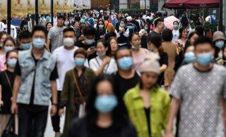 """""""У нас повсюду толпы"""": Пока мир на осадном положении из-за пандемии — в китайском Ухане, где год назад все это началось, вируса давно нет"""