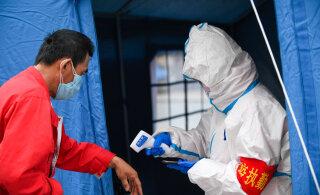 Главный китайский эпидемиолог предупреждает о второй волне пандемии COVID-19