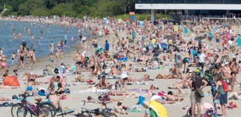 FOTOD | Ilus ilm ja soe vesi on toonud Pirita randa rahvamassi